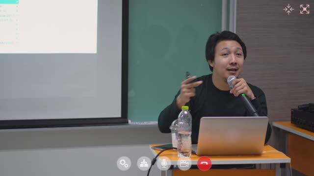 vídeos de stock e filmes b-roll de asian man online teaching conference - aula de formação
