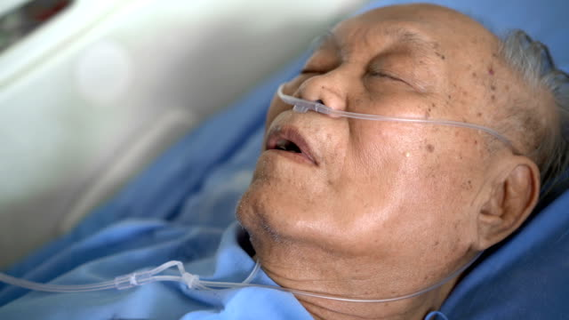 asian man patient sleeping in hospital with oxygen tube - oxygen stock videos and b-roll footage
