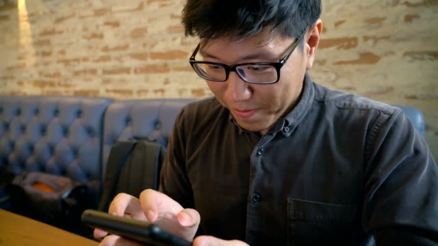 asian man photographing his breakfast on a smartphone - mack2happy stock videos and b-roll footage