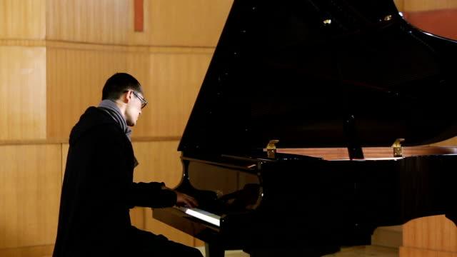 Asian man play piano