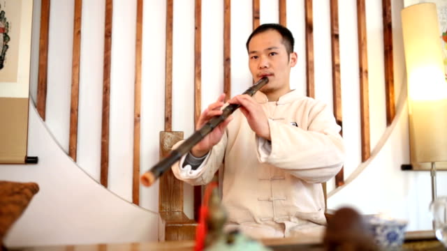 asian man playing xiao in the tai chi school - wind instrument stock videos & royalty-free footage