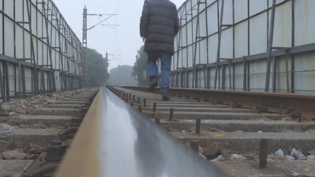 asian man running railroad trail - vanishing point stock videos and b-roll footage