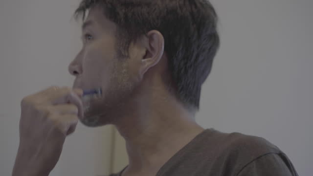 asian man shaving his beard - shaving stock videos & royalty-free footage