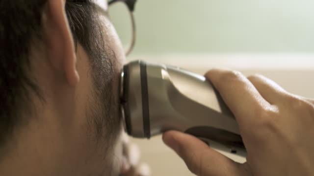 cu asian man shaving his sideburn - sideburn stock videos & royalty-free footage