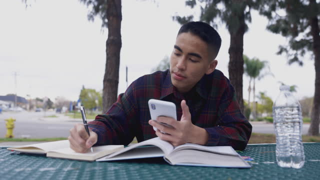 asian man studying at a picnic table - filipino ethnicity stock videos & royalty-free footage