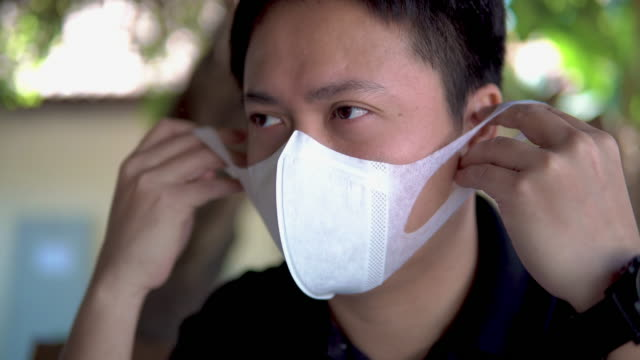 asian man suffer from cough with face mask protection. - asian man coughing stock videos & royalty-free footage