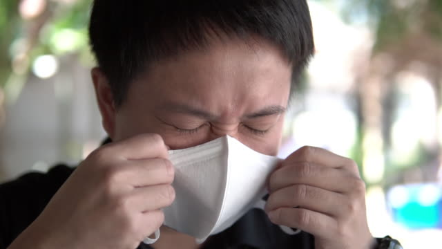 asian man suffer from cough with face mask protection. - sudden acute respiratory syndrome stock videos & royalty-free footage