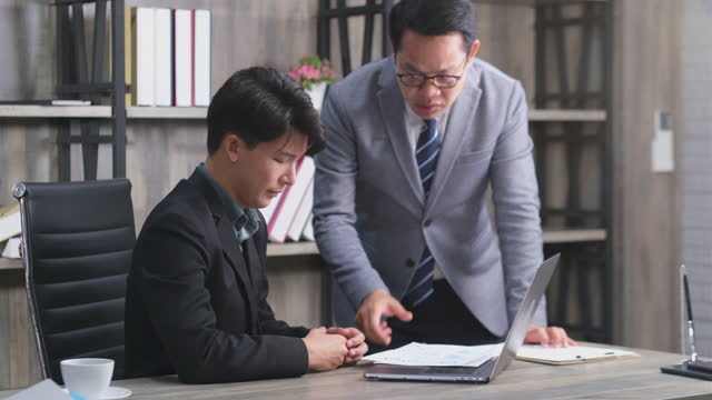 asian man supervisor is blaming his senior employee for bad business result. - communication problems stock videos & royalty-free footage