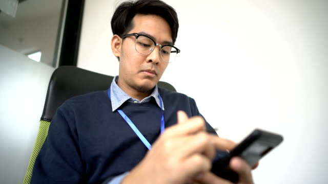 Asian Man Taking note on his Smart Phone with Digitzed pen