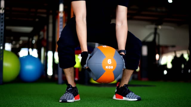 asian man training with fitness ball in gym - fitness ball stock videos & royalty-free footage