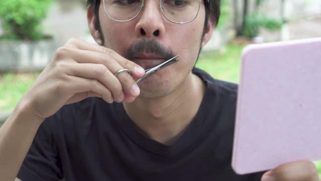 asian man trimming his moustache - moustache stock videos & royalty-free footage