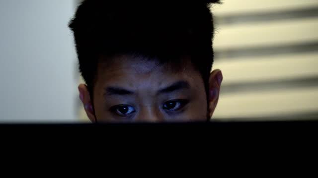 cu rt asian man using lap top - sideburn stock videos & royalty-free footage