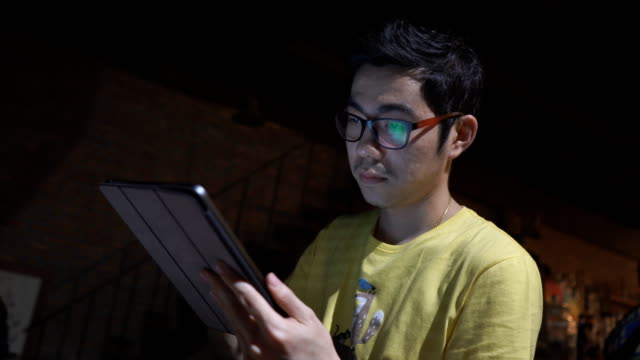 asian man using tablet,touchpad in cafe/bar at night - touchpad stock videos & royalty-free footage