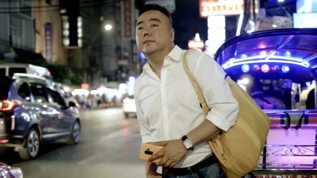 asian man waiting for taxi - tricycle stock videos & royalty-free footage