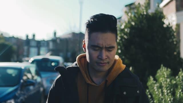 asian man walking in london - modern manhood stock videos & royalty-free footage