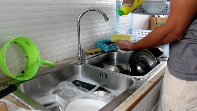 asian man washing kitchenware - washing up stock videos and b-roll footage