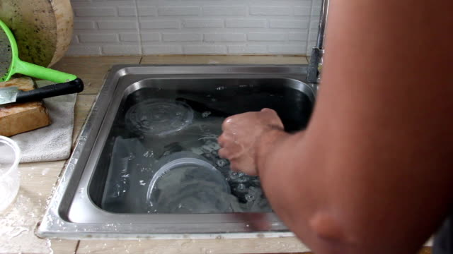 asian man washing kitchenware - washing up stock videos and b-roll footage