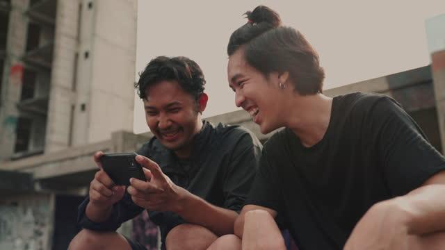 asian man watch video playing football - facial hair stock videos & royalty-free footage
