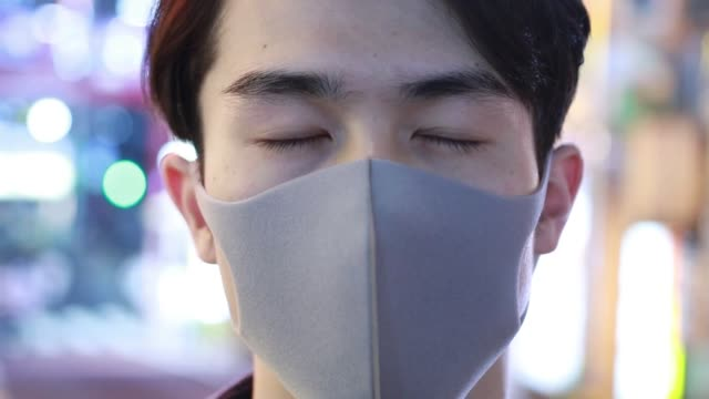 asian man wearing protective face mask - human face stock videos & royalty-free footage