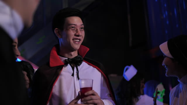 asian man wearing vampire costume in halloween party - dungeon stock videos & royalty-free footage