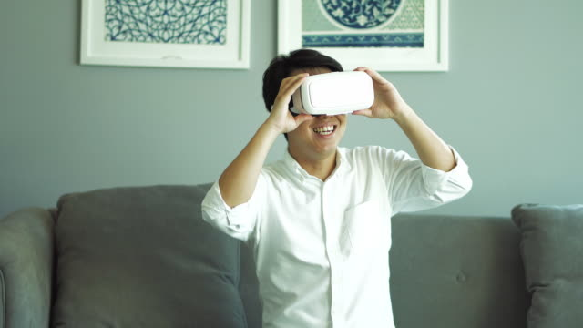 asian man wearing virtual reality headset - one mid adult man only stock videos & royalty-free footage