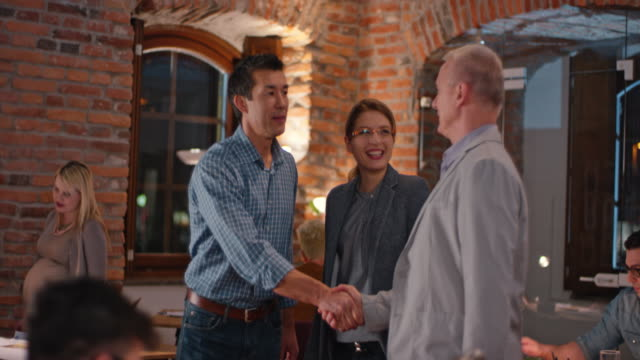 Asian man welcoming a client in the startup office