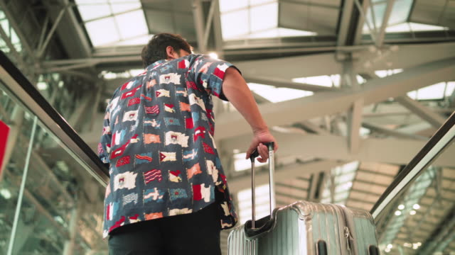 asian man with a gray suitcase, go to the check-in counter airline airport - transportation building type of building stock videos & royalty-free footage