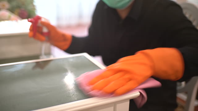 asian man with protective mask and glove disinfecting dressing table - washing up glove stock videos & royalty-free footage