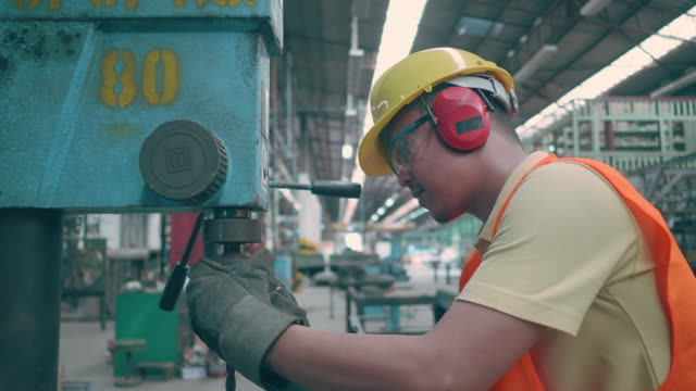 asian man worker working on drill - work tool stock videos & royalty-free footage