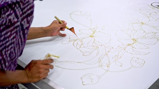 asian man working in batik workshop - batik stock videos & royalty-free footage
