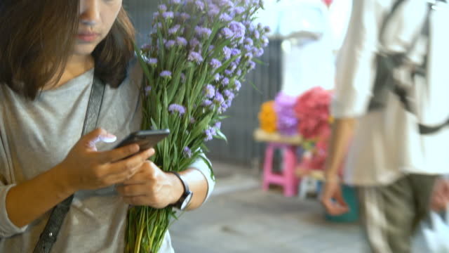 asian market : attractive woman using mobile phone - asian market stock videos and b-roll footage