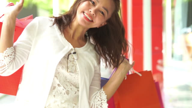 asian mature businesswoman cheerful with shopping bags,slow motion - human limb stock videos & royalty-free footage