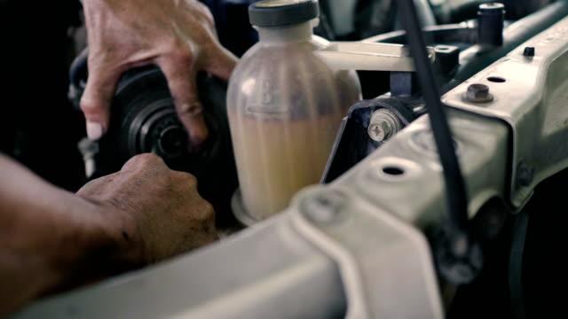 asian mechanic man maintenance car engine - bolt stock videos & royalty-free footage