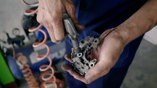 asian mechanic man maintenance electric motor. 4k - anatomical valve stock videos & royalty-free footage