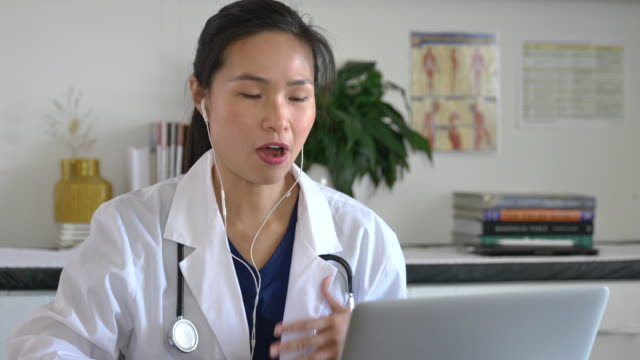 asian medical professional doing a remote appointment - fatcamera stock videos & royalty-free footage