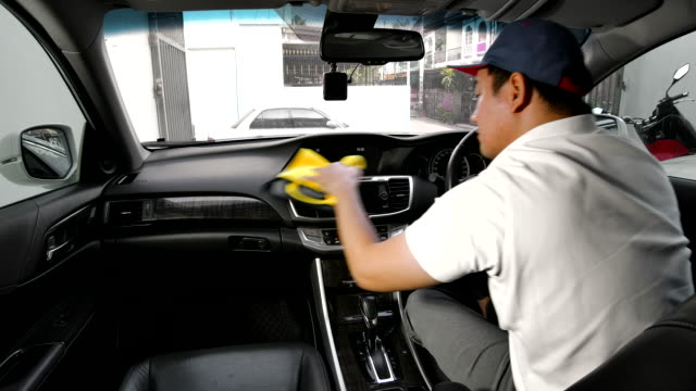 asian men are cleaning the interior of the customers' cars at car detailing shop. - vehicle interior stock videos & royalty-free footage