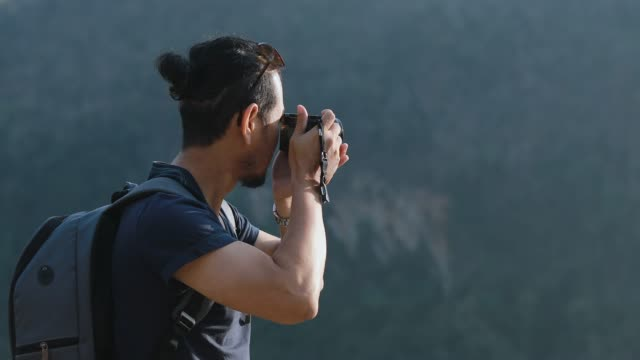 asian men backpacks and traveler walking together and happy are taking photo on forest  ,relax time on holiday concept travel - photographer stock videos & royalty-free footage