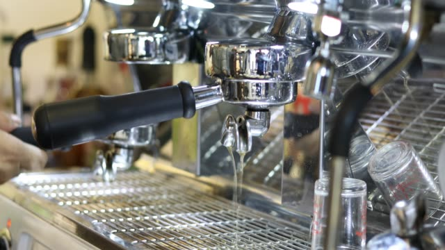 4K Asian men Barista using coffee machine in coffee shop counter - Working woman small business owner food and drink cafe concept