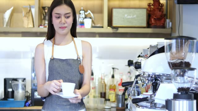 4k asian men barista using coffee machine in coffee shop counter - working woman small business owner food and drink cafe concept - coffee drink stock videos and b-roll footage