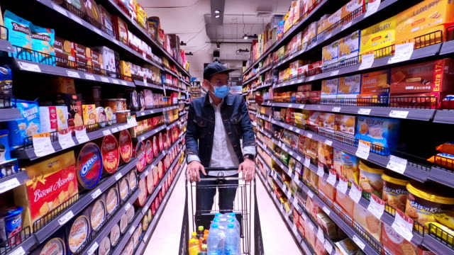 asian men buy and shopping food  for hoarding in during the coronavirus outbreak - household equipment stock videos & royalty-free footage