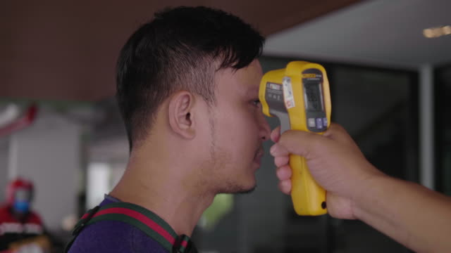asian men measure fever using a checker - thermometer stock videos & royalty-free footage