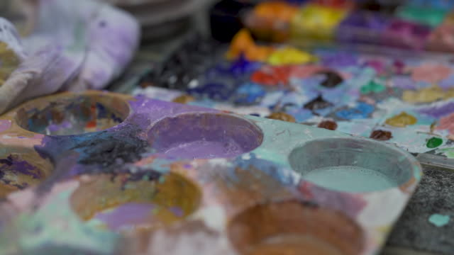 asian men mixing paints, painting, hobby - acrylic painting stock videos & royalty-free footage