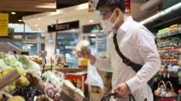 Asian Men Wear a mask to protect and he shopping In the supermarket.