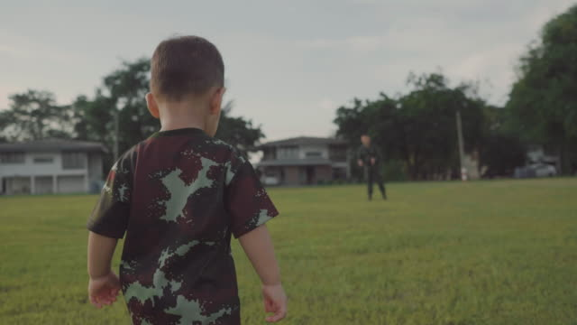 asian military soldier reunites with son - homecoming stock videos & royalty-free footage