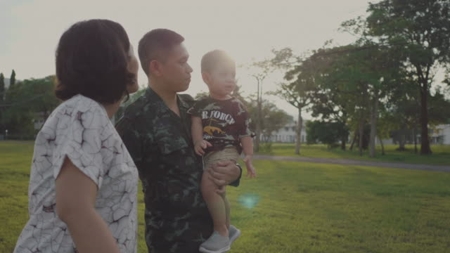 Asian military soldier reunites with son