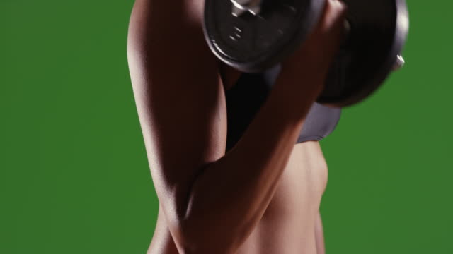 asian millennial woman lifting weights at the gym on green screen - bra stock videos & royalty-free footage