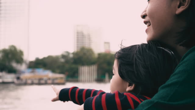 asian mom and son watching river view - riverbank stock videos & royalty-free footage