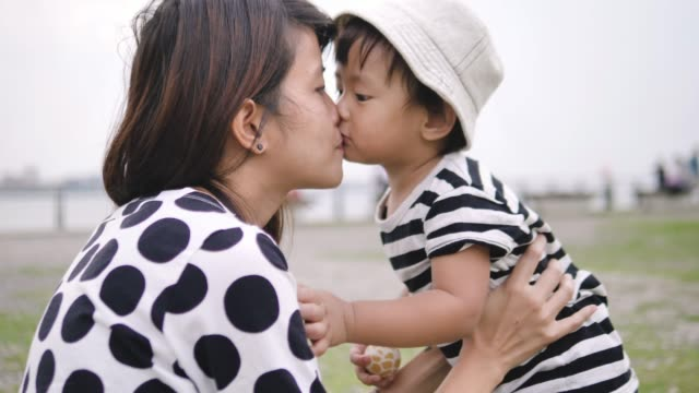 asian mother and baby having fun outdoors. - baby boys stock videos & royalty-free footage