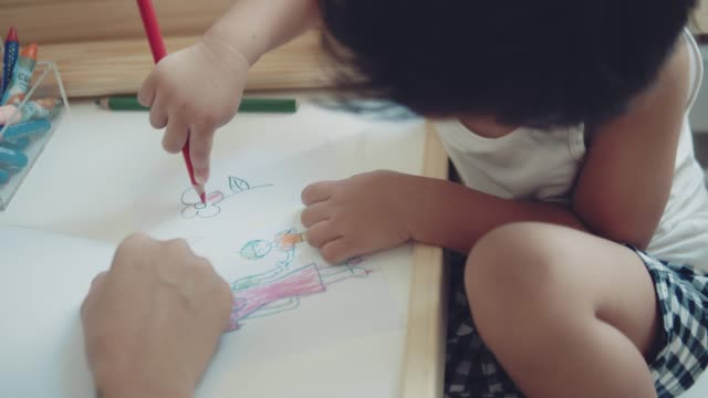 asian mother and child making greeting card for mothers day on the table in room at home. bangkok, thailand. - nursery school child stock videos & royalty-free footage