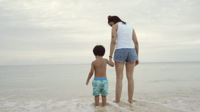 Asian Mother and Son Playing at the Beach